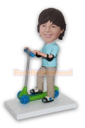 Boy with Elbow Pads Riding a Scooter Bobblehead